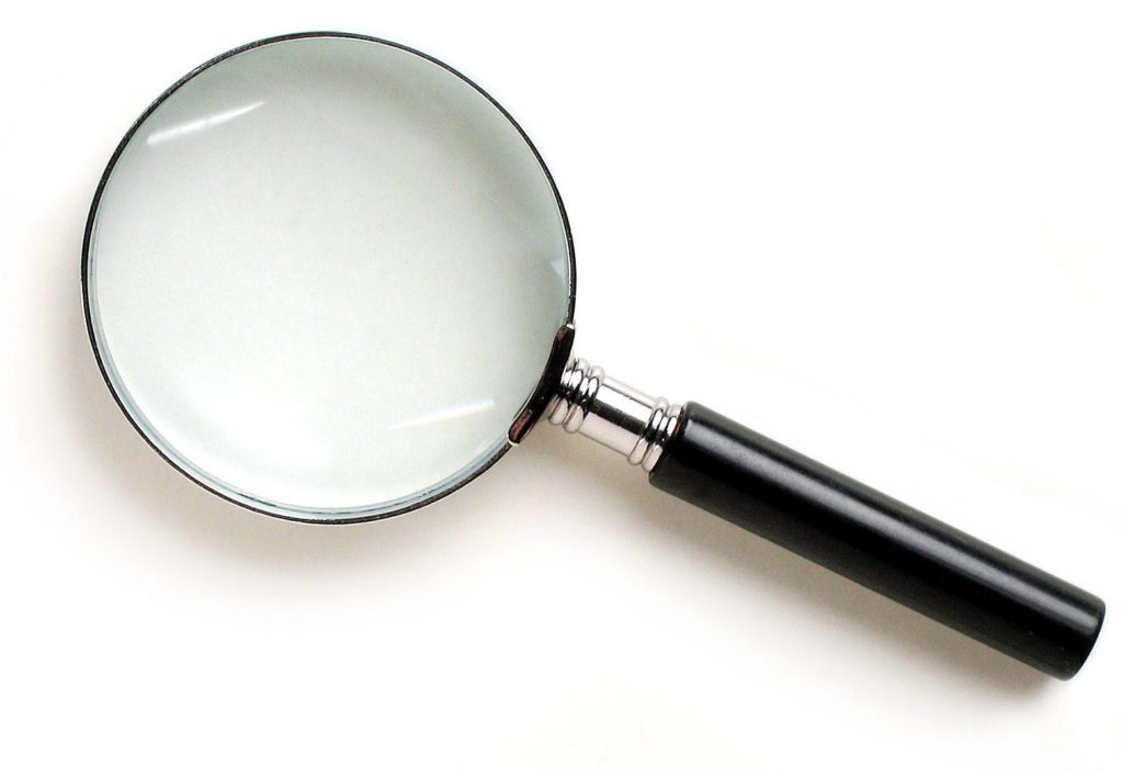 Magnifying glass to show the importance of focus in time management