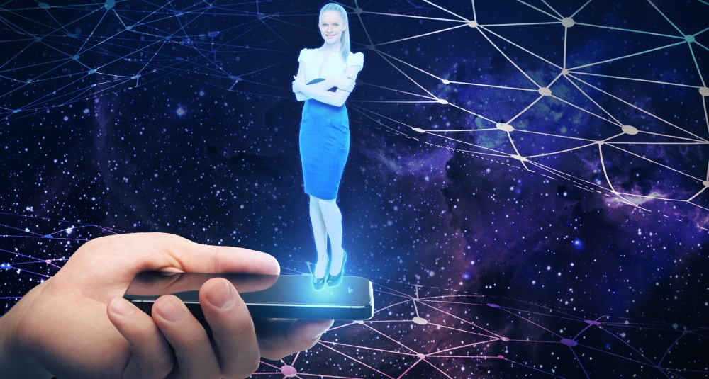 Holographic projection of a lady speaking online from a smartphone.
